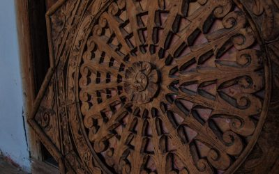 Elaboate wood carvings decorate the ceilings